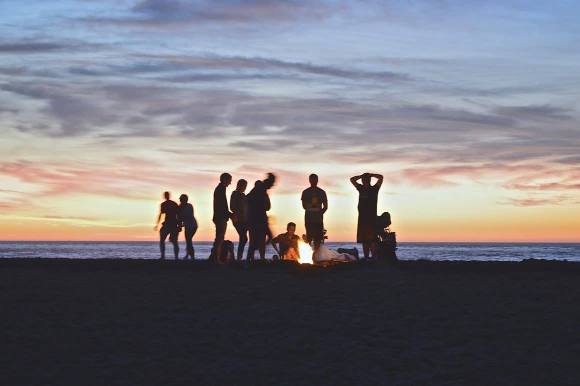 Friends around a bon fire at the beach