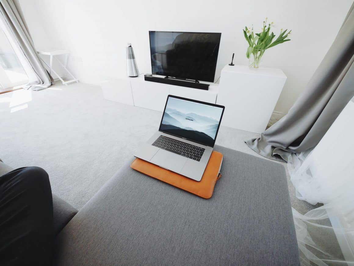 A laptop in a really, nice minimalist apartment --feels a little like the Death Start, only with cusions